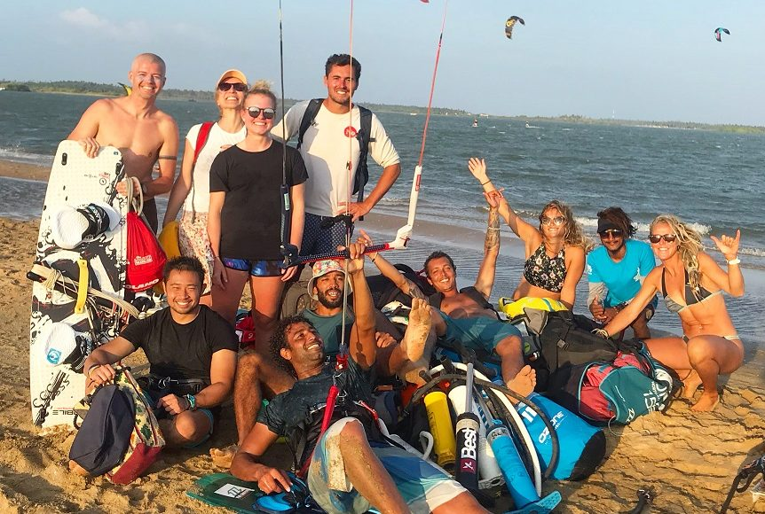 Group of happy kitesurfers having fun in Kalpitiya
